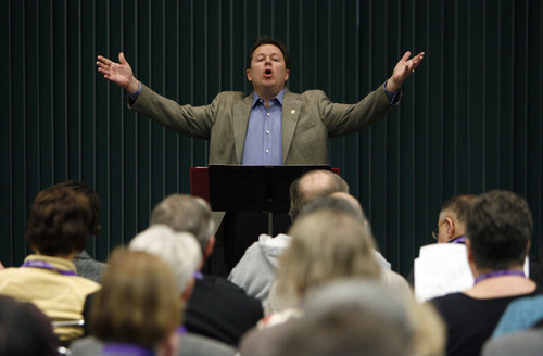 Francisco Kjolseth  |  The Salt Lake Tribune Composer David Kauffman, founder of Good for The Soul Music in San Antonio, engages his audience to sing as as some 1,200 Catholics from the United States, Canada and Guam gathered recently for the Southwest Liturgical Conference Study Week at the Salt Palace in Salt Lake City.