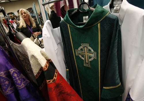 Francisco Kjolseth  |  The Salt Lake Tribune Mannix Delfino of Chagall Design, based in California, displays her Clergy vestments as some 1,200 Catholics from the United States, Canada and Guam gathered recently for the Southwest Liturgical Conference Study Week at the Salt Palace in Salt Lake City.