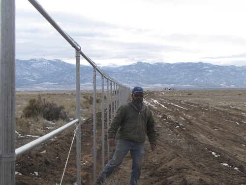 Mark Havnes     The Salt Lake Tribune  Kevin Robinson next to fence posts on Friday, Feb. 4, 2011, erected by his Cedar City company to secure a solar project planned for Iron County.