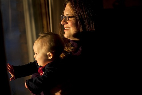 Photo by Chris Detrick | The Salt Lake Tribune  Amanda Esko and her 9.5 month old baby Grace pose for a portrait at their home in Salt Lake City Tuesday February 8, 2011.