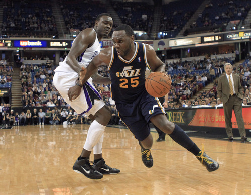 Utah Jazz center Al Jefferson, right, drives to the basket past Sacramento Kings center Samuel Dalembert during the first quarter of an NBA basketball game in Sacramento, Calif., Monday, Feb. 7, 2011. (AP Photo/Rich Pedroncelli)