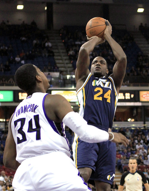 Utah Jazz forward Paul Millsap shoots over Sacramento Kings forward Jason Thompson during the first quarter of an NBA basketball game in Sacramento, Calif., Monday, Feb. 7, 2011. (AP Photo/Rich Pedroncelli)
