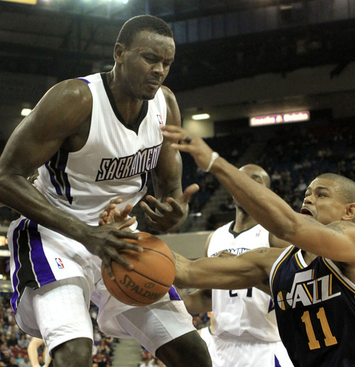 Utah Jazz guard Earl Watson, right, steals the ball from Sacramento Kings center Samuel Dalembert during the fourth quarter of an NBA basketball game in Sacramento, Calif., Monday, Feb. 7, 2011. The Jazz won 107-104. (AP Photo/Rich Pedroncelli)