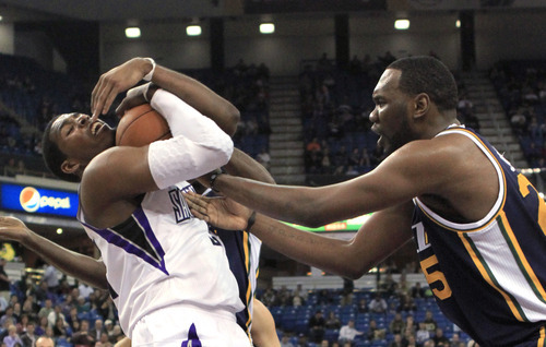 Sacramento Kings forward Jason Thompson, left, pulls a rebound away from Utah Jazz center Al Jefferson during the first quarter of an NBA basketball game in Sacramento, Calif., Monday, Feb. 7, 2011. (AP Photo/Rich Pedroncelli)