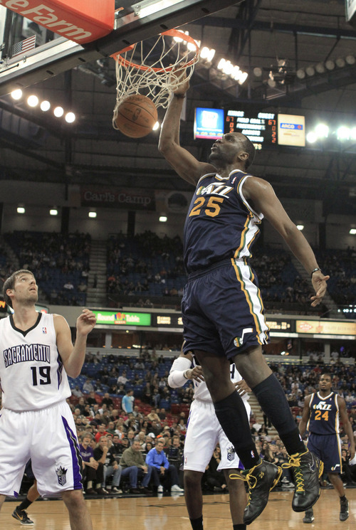 Utah Jazz center Al Jefferson, right, dunks over Sacramento Kings guard Beno Udrih, left, of Slovenia, during the first quarter of an NBA basketball game in Sacramento, Calif., Monday, Feb. 7, 2011. (AP Photo/Rich Pedroncelli)