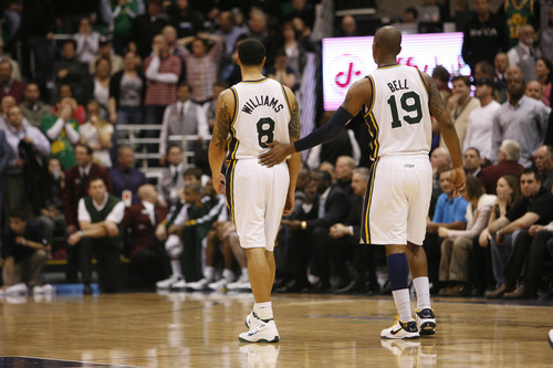 Rick Egan  |  The Salt Lake Tribune  Raja Bell pats Deron Williams on the back as the Jazz chances of winning the game were dashed on a turnover, in a game vs. Chicago, in Salt Lake City, Wednesday, Feb. 9, 2011. Williams is being traded to the New Jersey Nets.