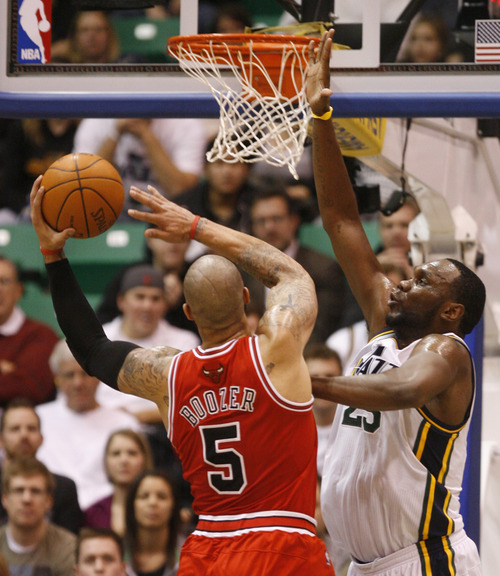 Rick Egan  |  The Salt Lake Tribune  Carlos Boozer shoots over Al Jefferson, in NBA action Utah vs. Chicago, in Salt Lake City, Wednesday, February 9, 2011