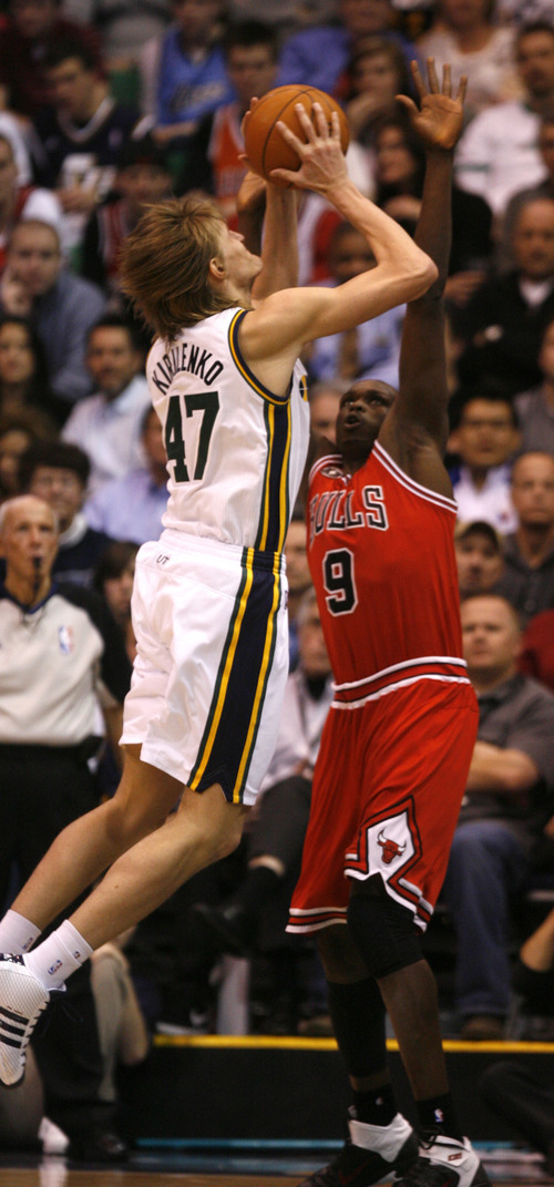 Rick Egan  |  The Salt Lake Tribune  Andre Kirilenko shoots over Luol Deng, in NBA action Utah vs. Chicago, in Salt Lake City, Wednesday, February 9, 2011