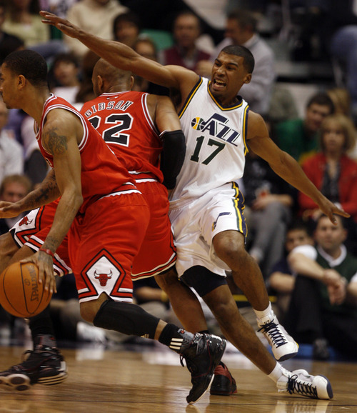 Rick Egan  |  The Salt Lake Tribune  Ronnie Price (17) is blocked by Taj Gibson, in NBA action Utah vs. Chicago, in Salt Lake City, Wednesday, February 9, 2011