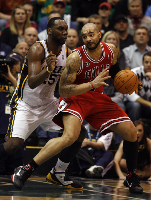Rick Egan  |  The Salt Lake Tribune  Carlos Boozer goes one on one with Al Jefferson, in NBA action Utah vs. Chicago, in Salt Lake City, Wednesday, February 9, 2011