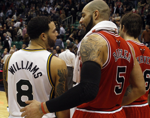 Rick Egan  |  The Salt Lake Tribune  Deron Williams gives Carlos Boozer a hug after the Jazz were defeated by the Bulls, in Salt Lake City, Wednesday, February 9, 2011