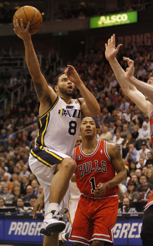 Rick Egan  |  The Salt Lake Tribune  Deron Williams scores for the Jazz, in NBA action, Utah vs Chicago,  in Salt Lake City, Wednesday, February 9, 2011