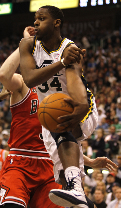 Rick Egan  |  The Salt Lake Tribune  CJ Miles passes the ball off for the Jazz, in NBA action, Utah vs Chicago,  in Salt Lake City, Wednesday, February 9, 2011