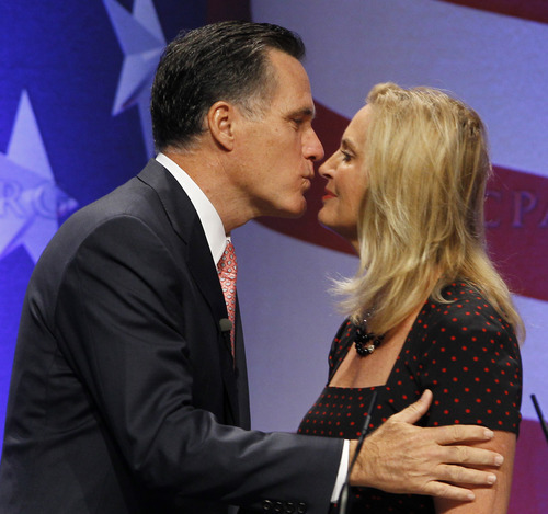 Mitt Romney kisses his wife Ann Romney, who introduced him, before he speaks at the Conservative Political Action Conference (CPAC) in Washington, Friday, Feb. 11, 2011.(AP Photo/Alex Brandon)