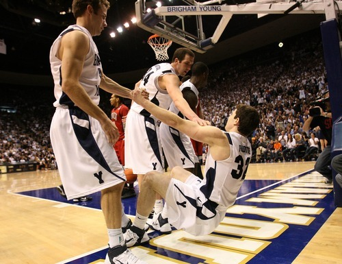 Leah Hogsten  |  The Salt Lake Tribune BYU guard Jackson Emery (4)  and BYU forward Noah Hartsock (34)  pull BYU guard Jimmer Fredette (32)  up off the floor after scoring and drawing the foul in the final moment of the game.  The Brigham Young University Cougars defeated UNLV Saturday, February 5, 2011, in Provo, 78-64 at the Marriott Center.