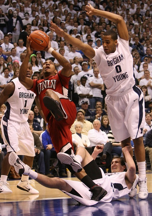 Leah Hogsten  |  The Salt Lake Tribune UNLV guard Anthony Marshall (3) steps on BYU forward Noah Hartsock (34) while driving to the basket past BYU forward Brandon Davies (0).  The Brigham Young University Cougars defeated UNLV Saturday, February 5, 2011, in Provo, 78-64 at the Marriott Center.