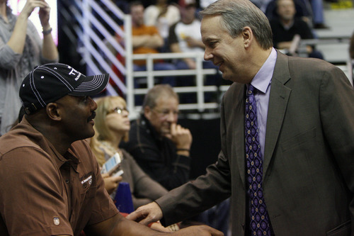 Photo by Chris Detrick   The Salt Lake Tribune  Karl Malone talks with Randy Rigby during the first half of the game against Phoenix at the EnergySolutions Arena Friday February 11, 2011.