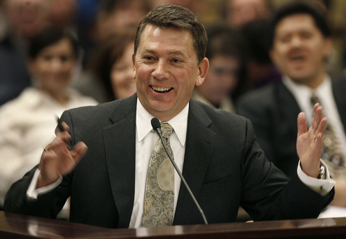 Scott Sommerdorf  |  The Salt Lake Tribune Rep. Stephen Sandstrom, R-Orem, laughs while commenting on a hypothetical situation about a streaking jogger being asked for his identification. Committee meeting to discuss Rep. Sandstrom's HB70, Friday, February 11, 2011.