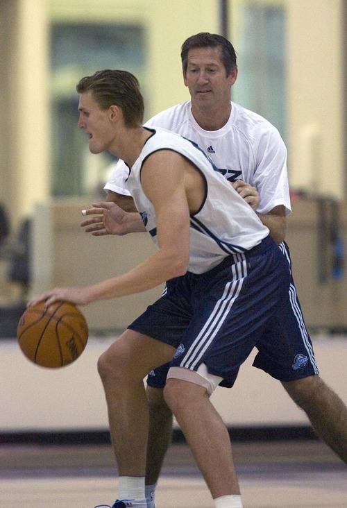 Al Hartmann  |  The Salt Lake Tribune    9/29/2009 Jazz's Andrei Kirelenko, left,  drives past former player, now special shooting coach Jeff Hornacek during team practice on Wednesday September 30th.