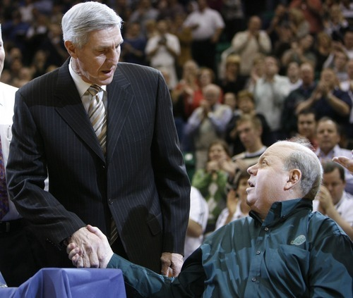 Steve Griffin  |  The Salt Lake Tribune  Utah Jazz head coach Jerry Sloan shakes hands with Utah Jazz owner Larry Miller as Sloan is honored for winning his 1,000th game with the Jazz on Nov. 19, 2008.