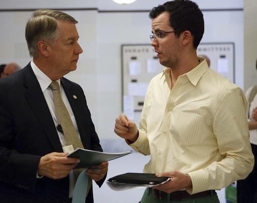 Trent Nelson  |  The Salt Lake Tribune Lobbyist Greg Smith, right, speaks to Sen. John Valentine at the state capitol in Salt Lake City, Utah, Tuesday, February 8, 2011.