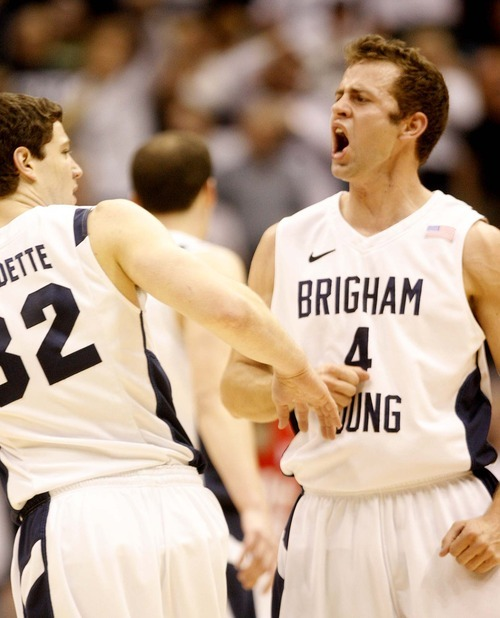 Trent Nelson  |  The Salt Lake Tribune BYU's Jimmer Fredette and BYU's Jackson Emery celebrate in the second half at BYU vs. Utah, college basketball in Provo, Utah, Saturday, February 12, 2011. BYU won 72-59.