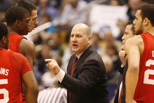 Trent Nelson  |  The Salt Lake Tribune Utah coach Jim Boylen during a timeout in the first half at BYU vs. Utah, college basketball in Provo, Utah, Saturday, February 12, 2011.