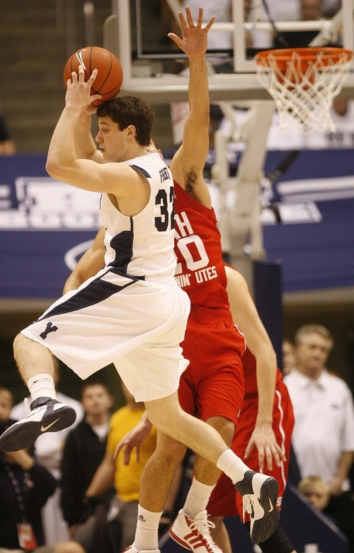 Trent Nelson  |  The Salt Lake Tribune BYU's Jimmer Fredette looks to pass in the second half at BYU vs. Utah, college basketball in Provo, Utah, Saturday, February 12, 2011. BYU won 72-59.
