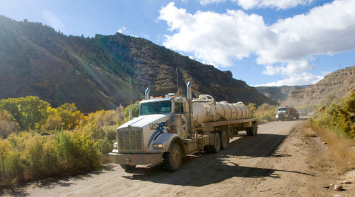 Al Hartmann  |  The Salt Lake Tribune Bill Barrett Corp. water trucks make their along the dirt road in Nine Mile Canyon. Just above the road are hundreds of examples of rock art that can be impacted by the dust thrown up by the large trucks. Bill Barrett Corp. operates many gas wells in the area and has agreed to fund cultural resources field work, monitoring, rock art conservation and mitigation plans.