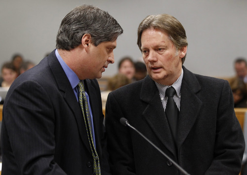 George Frey | The Associated Press  Keith Brown, right, talks to his attorney Steven Shapiro at his hearing in Provo 4th District Court on Thursday, Feb. 17, 2011. Brown, the father of the musical group
