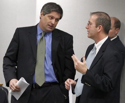 Steven Shapiro, attorney for Keith Brown, left, talks with prosecutor Dave Sturgill before a hearing for his client in Provo 4th District Court in Provo, Utah, Thursday, Feb. 17, 2011. Brown, the father of the musical group