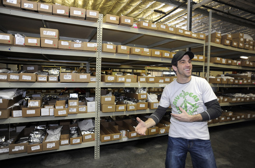 Sarah A. Miller  |  The Salt Lake Tribune  Mountain Valley Seed Co. co-owner Robb Baumann shows the aisles of seeds in storage in the warehouse of his Salt Lake City company.