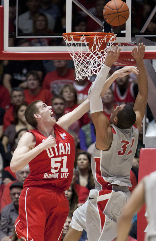 Utah's David Foster (51) blocks a shot by New Mexico's Drew Gordon during the first half of an NCAA basketball game at the Pit, Saturday, Feb. 19, 2011, in Albuquerque, N.M. (AP Photo/Craig Fritz)
