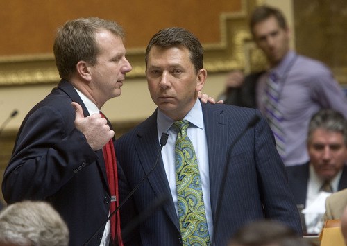 AL HARTMANN  |  The Salt Lake Tribune  Rep. Stephen Sandstrom, R-Orem, right, takes time out during Friday's debate on his enforcement-only immigration bill to confer with Rep. Chris Herrod, R-Provo. The measure, after being amended for the second time in two weeks passed the House overwhelmingly, 58-15. It now goes to the Senate.