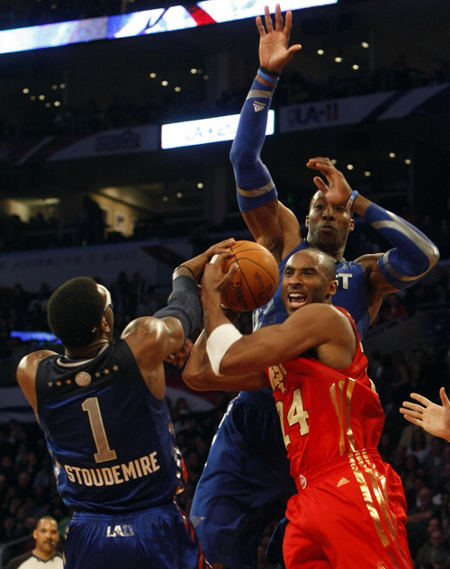 Photo by Chris Detrick | The Salt Lake Tribune  Kobe Bryant is guarded by Amar'e Stoudemire and Dwight Howard during the second half of the 2011 NBA All-Star game at the Staples Center Sunday February 20, 2011.    The West won 148-143.