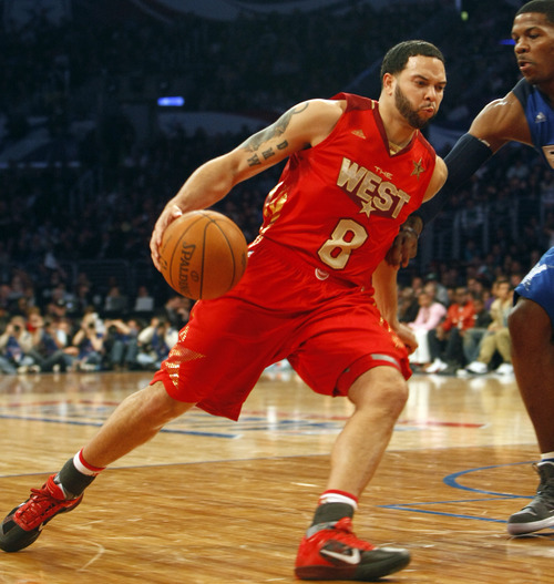 Photo by Chris Detrick | The Salt Lake Tribune  Utah Jazz's Deron Williams is guarded by Joe Johnson during the second half of the 2011 NBA All-Star game at the Staples Center Sunday February 20, 2011.    The West won 148-143.