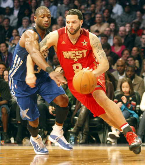 Photo by Chris Detrick | The Salt Lake Tribune  Utah Jazz's Deron Williams runs around Dwayne Wade during the second half of the 2011 NBA All-Star game at the Staples Center Sunday February 20, 2011.    The West won 148-143.