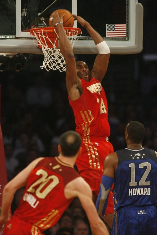 Photo by Chris Detrick | The Salt Lake Tribune  Kobe Bryant dunks the ball during the first half of the 2011 NBA All-Star game at the Staples Center Sunday February 20, 2011.    The West won 148-143.