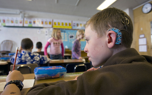 Al Hartmann   |  The Salt Lake Tribune  Gavin Bottomly, a third-grader at Mill Creek Elementary, follows the day's lesson with his class. He has a cochlear implant but is integrated into a regular classroom. Utah Schools for the Deaf has 30 students at Mill Creek who may spend a portion or all of their day in self-contained classrooms with teachers trained in listening-and-spoken language instruction.