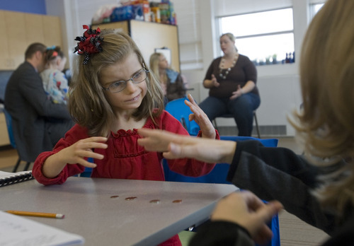 Al Hartmann   |  The Salt Lake Tribune  Kindergartner Sarah Gubler has a discussion in American Sign Language during a lesson in counting change with her teacher Amee Breinholt at the Jean Massieu School of the Deaf in Millcreek.