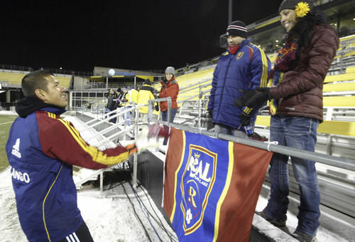 Chris Parker for The Tribune  Real Salt Lake's keeper, Nick Rimando (l), tosses his beanie to fans Brian Kramer and Laurie Ramirez before their CONCACAF Champions League game at Columbus Crew Stadium Tuesday, February 22, 2011. Kramer and Ramirez moved to North Carolina from Salt Lake 1 1/2 years ago, but made the 5 hour trip to Columbus to watch Real Salt Lake.