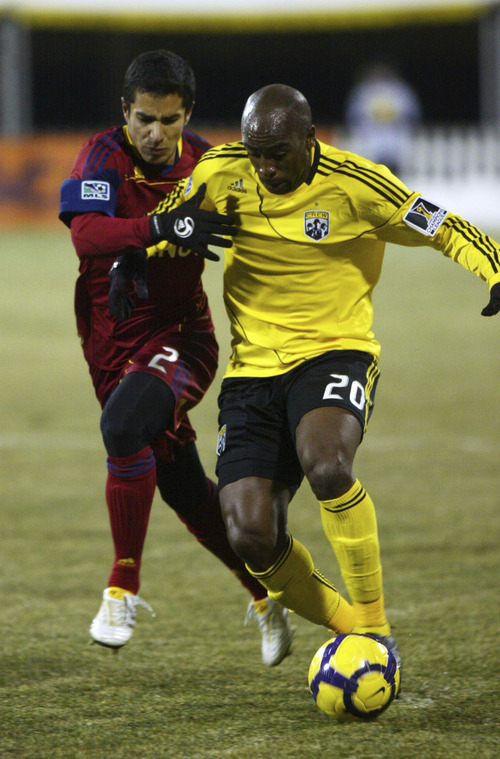Chris Parker | Special to The Tribune  Real Salt Lake's Tony Beltran, left, chases down the Columbus Crew's Emilio Renteria during a CONCACAF Champions League game at Columbus Crew Stadium Tuesday, February 22, 2011. Real Salt Lake tied the Columbus Crew 0-0.