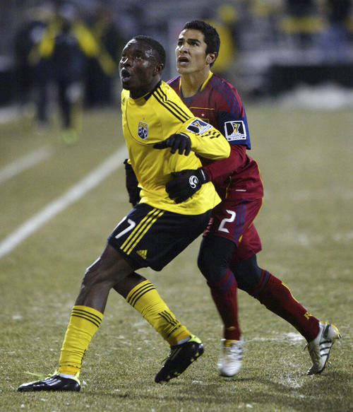 Chris Parker for The Tribune  Real Salt Lake's Tony Beltran (r) battles the Columbus Crew's Emmanuel Ekpo (l) for position during a CONCACAF Champions League game at Columbus Crew Stadium Tuesday, February 22, 2011. Real Salt Lake tied the Columbus Crew 0-0.