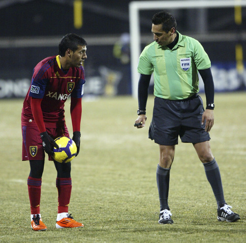 Chris Parker for The Tribune  The referee has a word with Real Salt Lake's Javier Morales about his ball placement before a free kick during a CONCACAF Champions League game at Columbus Crew Stadium Tuesday, February 22, 2011. Real Salt Lake tied the Columbus Crew 0-0.