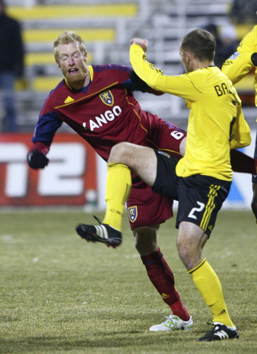 Chris Parker for The Tribune  Real Salt Lake's Nat Borcher battles the Columbus Crew's Rich Balchan (r) for the ball in front of Columbus' goal during a CONCACAF Champions League game at Columbus Crew Stadium Tuesday, February 22, 2011. Real Salt Lake tied the Columbus Crew 0-0.