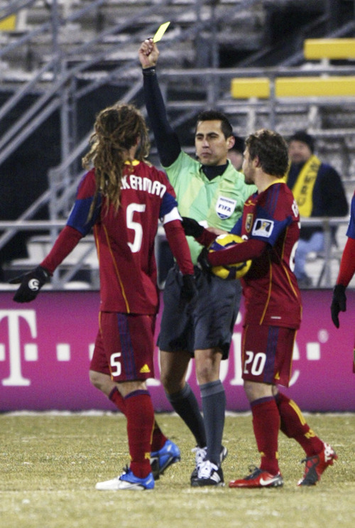 Chris Parker for The Tribune  Real Salt Lake's Kyle Beckerman (l) is shown a yellow card by the referee as his Ned Grabavoy (r) tries to intercede during a CONCACAF Champions League game at Columbus Crew Stadium Tuesday, February 22, 2011. Real Salt Lake tied the Columbus Crew 0-0.