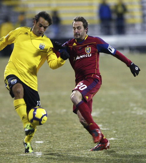 Chris Parker for The Tribune  Real Salt Lake's Ned Grabavoy (r) battles the Columbus Crew's Sebastian Miranda (l) for the ball during a CONCACAF Champions League game at Columbus Crew Stadium Tuesday, February 22, 2011. Real Salt Lake tied the Columbus Crew 0-0.
