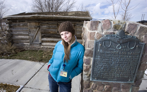 Steve Griffin  |  The Salt Lake Tribune   Chelsea Rushton, director of the Midvale Museum, stands at the Drown Log Cabin in Midvale on Thursday, Feb. 17, 2011. Rushton, with the help of others, is restoring the cabin, which was erected in 1866 and is the last standing pioneer farm home in the Midvale area.  It was built near the corner of Center and Main streets in Midvale but now stands about two blocks west of that spot.