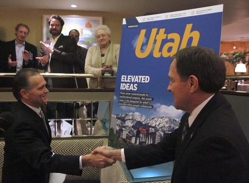 Rick Egan      The Salt Lake Tribune Delta Air Lines Vice President of Airport Customer Service Greg Kennedy, left, and Gov. Gary R. Herbert shake hands after unveiling the cover of the upcoming Sky magazine, at the New Yorker, Thursday, Feb. 24, 2011. Utah's tourism promotion efforts are expected to get a boost when the March issue of Delta Air Lines' in-flight magazine appears in planes, exposing an estimated 5 million readers to a 50-page section on Utah.