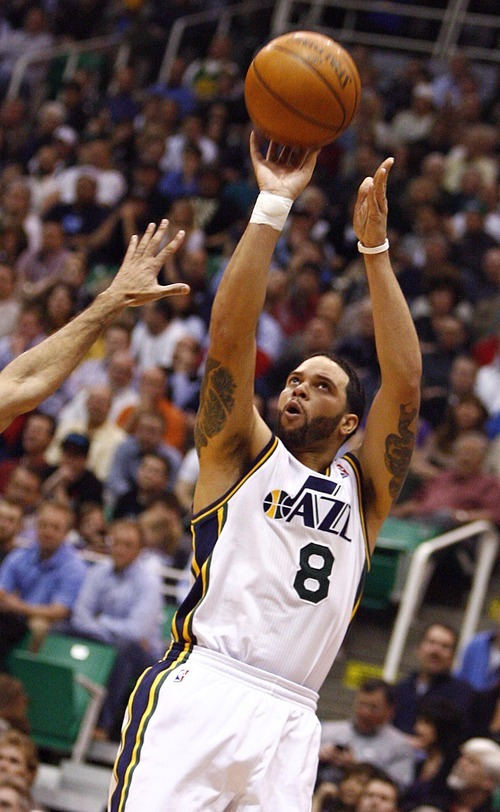 Djamila Grossman  |  The Salt Lake Tribune  The Jazz' Deron Williams shoots the ball during the second half of a game against the San Antonio Spurs in Salt Lake City, Wednesday, Jan. 26, 2011. The Jazz lost the game.